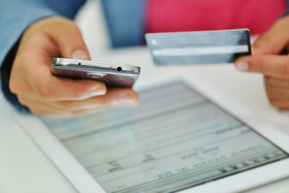 Human hand on tablet pc and credit card for shopping online.jpeg