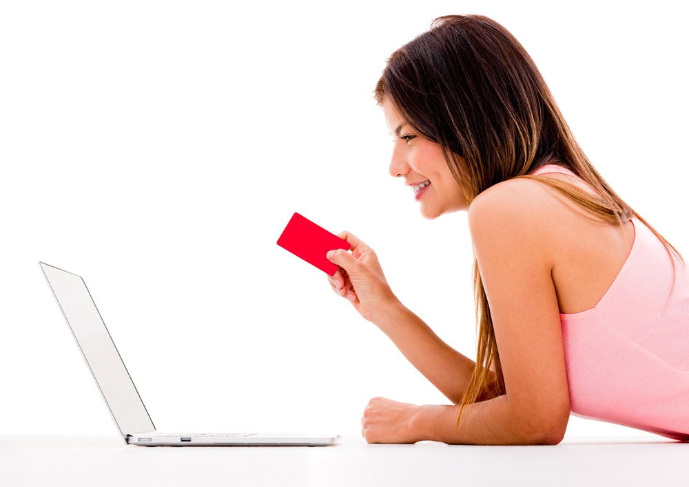 Woman online shopping with her laptop - isolated over white.jpeg