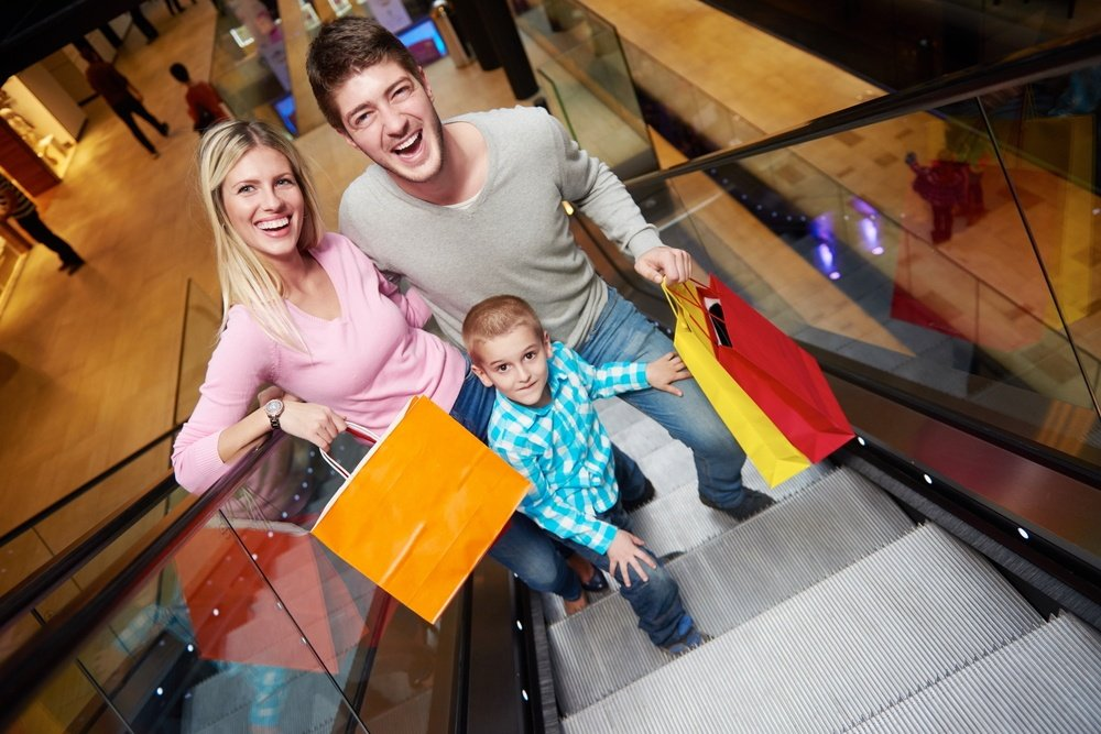happy young family portrait in shopping mall